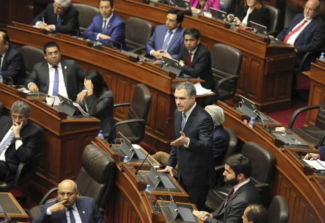 Peruvian Prime Minister Salvador del Solar, center, asks for a vote of confidence for his administration during a legislative session, in Lima, Peru, Monday, Sept. 30, 2019. The political duel between Peruvian President Martin Vizcarra and Congress intensified in recent weeks after lawmakers decided to shelve Vizcarra's proposal to hold early presidential and congressional elections, which he argues is necessary to break the deadlock and stabilize the nation. (AP Photo/Martin Mejia)