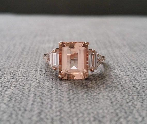 """<i>Buy it from<a href=""""https://www.etsy.com/listing/543118053/upgraded-peach-morganite-and-diamond?ga_search_query=antique+engagement&ref=shop_items_search_58"""" target=""""_blank"""">PenelliBelle on Etsy</a>for$2,299.</i>"""