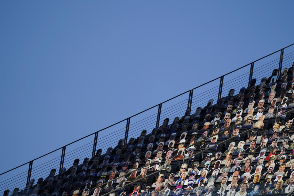 Cardboard cutouts of fans sit in the seats at Petco Park before Game 3 of a baseball American League Championship Series between the Houston Astros and the Tampa Bay Rays, Tuesday, Oct. 13, 2020, in San Diego. (AP Photo/Gregory Bull)
