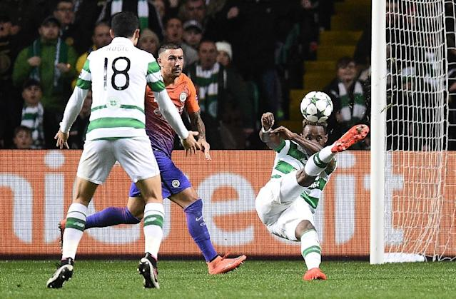Manchester City's defender Aleksandar Kolarov (2L) watches as Celtic's striker Moussa Dembele (R) scores his team's thrid goal during the UEFA Champions League Group C football match between Celtic and Manchester City on September 28, 2016 (AFP Photo/Oli Scarff)