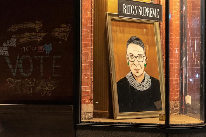 People are dedicating art, baked goods and tattoos to Ruth Bader Ginsburg across the country this weekend. The Supreme Court justice died at age 87 after a battle with pancreatic cancer. (Photo: Jeenah Moon/Getty Images)