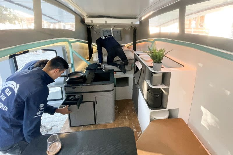 Students from Eindhoven's Technical University set up the interior of Stella Vita vehicle in Spain