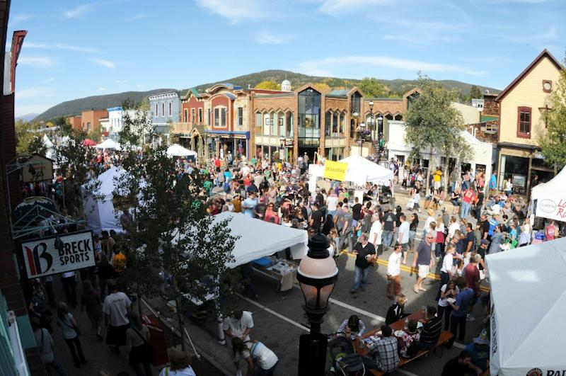 This 2012 photo provided by GoBreck shows crowds at the annual Oktoberfest celebration in Breckenridge, Colo. Breckenridge may be best known as a ski resort but it offers many summer and fall activities and events for visitors, along with offseason deals. (AP Photo/GoBreck, Robin Johnson)