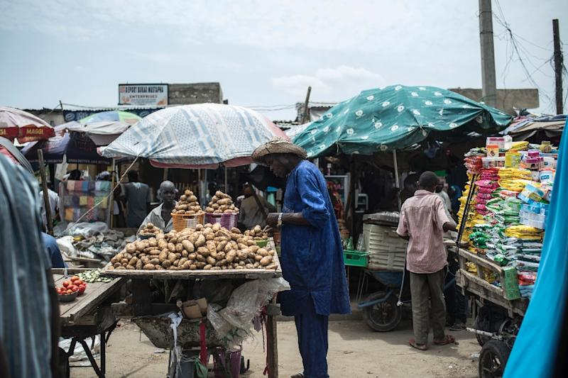 Food may be returning to Maiduguri's markets, but they still have to be imported and prices have shot up (AFP Photo/STEFAN HEUNIS)