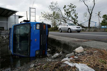 Super Typhoon Hits Taiwan Cutting Power And Transport