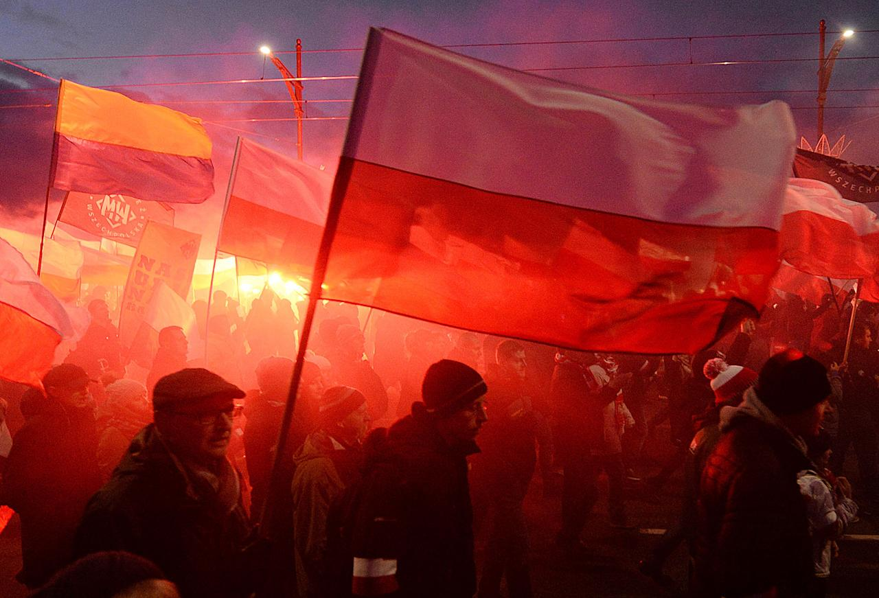<p>Demonstrators burn flares and wave Polish flags during the annual march to commemorate Poland's National Independence Day in Warsaw, Saturday, Nov. 11, 2017. Thousands of nationalists marched in Warsaw on Poland's Independence Day holiday, taking part in an event that was organized by far-right groups. (Photo: Czarek Sokolowski/AP) </p>