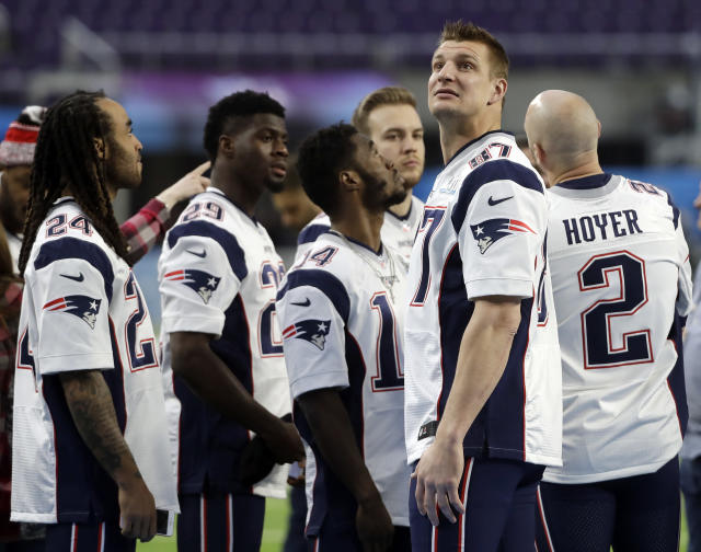 New England Patriots tight end Rob Gronkowski (87) looks around U.S. Bank Stadium before a team photo Saturday. (AP)