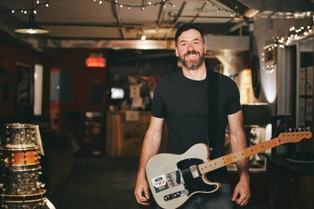 Patrick Mainville is a musician and founder of the Montreal Rock School which he is running as a day camp out of his Verdun music studio this summer. (Photo by Myriam Baril-Tessier - image credit)