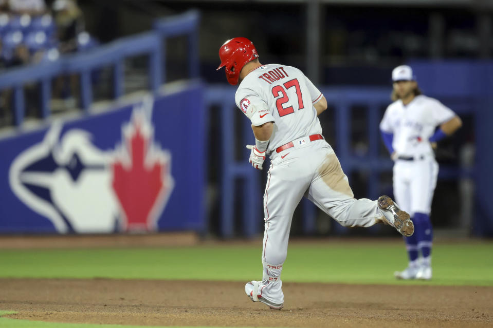 Los Angeles Angels' Mike Trout rounds the bases in front of Toronto Blue Jays shortstop Bo Bichette after his solo home run during the fifth inning of a baseball game Thursday, April 8, 2021, in Dunedin, Fla. (AP Photo/Mike Carlson)