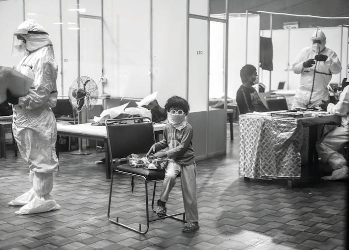 An infected child in isolation at a care facility