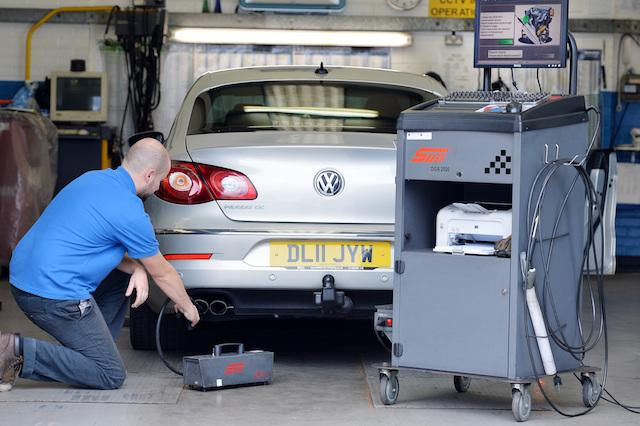 A Volkswagen Passat CC car is tested for its exhaust emissions, at a MOT (Ministry of Transport) testing station in Walthamstow, London, as the software used in Volkswagen's diesel cars to trick emissions testers in the US was also built into its European vehicles, according to Germany's transport minister.