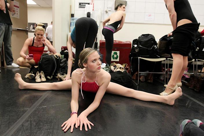 This image released by Starpix shows Liz Daniels, of San Diego, center, with other aspiring dancers as they prepare for an audition with the Rockettes, Tuesday, April 30, 2013 at Radio City Music Hall in New York. Hundreds of young women from around the country are vying to appear with The Rockettes at the 2013 Radio City Christmas Spectacular.  The aspiring dancers lined up Tuesday outside Radio City Music Hall for the open audition. Those who make it will return for the show that runs from Nov. 8 to Dec. 30.  (AP Photo/Starpix, Amanda Schwab)