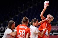 <p>Hungary's left back Noemi Hafra (R) is challenged by Norway's pivot Kari Brattset Dale (2ndR) during the women's quarterfinal handball match between Norway and Hungary of the Tokyo 2020 Olympic Games at the Yoyogi National Stadium in Tokyo on August 4, 2021. (Photo by Fabrice COFFRINI / AFP)</p>
