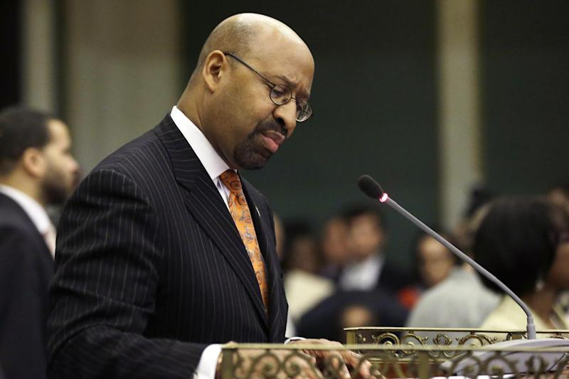 Mayor Michael Nutter attempts to delivers his budget address to city council at City Hall, Thursday, March 14, 2013, in Philadelphia. Deafening protests have forced Philadelphia Mayor Michael Nutter to abandon his traditional budget address in mid-speech. (AP Photo/Matt Rourke)