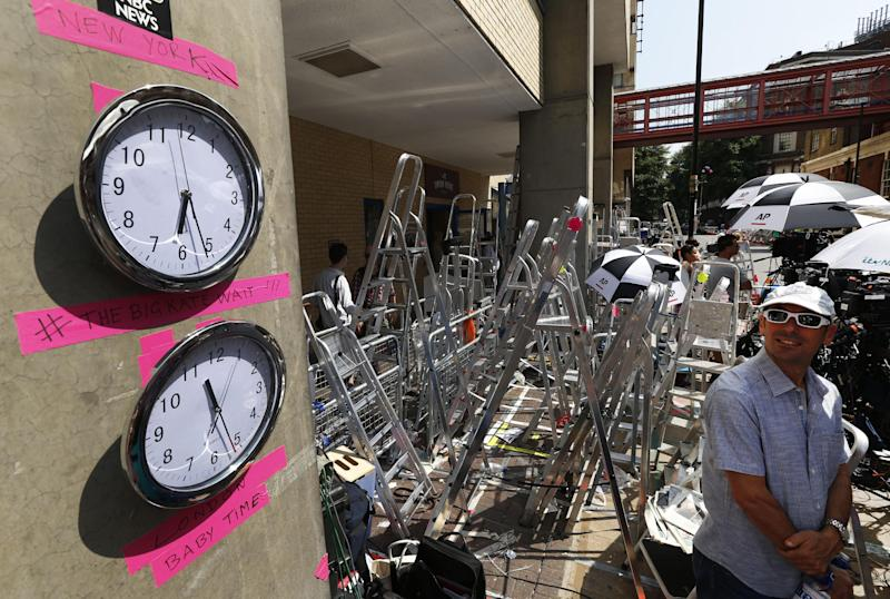 Clocks supposed to show New York and London time which were placed by members of the media are seen across St. Mary's Hospital exclusive Lindo Wing in London, Wednesday, July 17, 2013. Media are preparing for royal-mania as Britain's Duchess of Cambridge plans to give birth to the new third-in-line to the throne in mid-July, at the Lindo Wing. Cameras from all over the world are set to be jostling outside for an exclusive first glimpse of Britain's Prince William and the Duchess of Cambridge's first child.(AP Photo/Lefteris Pitarakis)