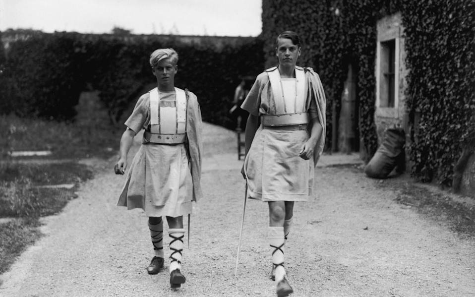 Prince Philip (left) in costume for a production of 'Macbeth' at his school, Gordonstoun in Scotland - Hulton Royals Collection