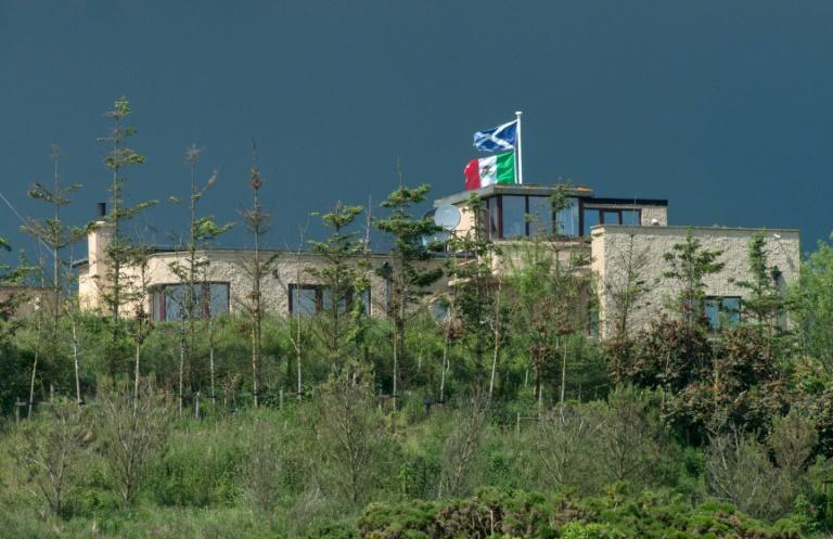 """David Milne erected a Mexican flag along with a Scottish one in 2016 """"as a token of respect and solidarity with the Mexican people"""" after Trump vowed to build a border wall -- but will take it down if the latter loses his re-election bid"""