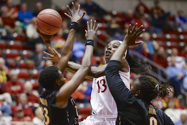 Stanford's Chiney Ogwumike (13) goes for a layup against Florida State's Natasha Howard (33) and Florida State's Kai James (0) in the second half of a second-round game in the NCAA women's college basketball tournament in Ames, Iowa, Monday, March 24, 2014. (AP Photo/Nati Harnik)