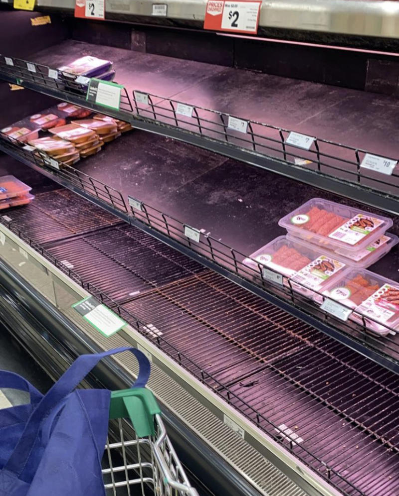 Empty shelves are seen at a Woolworths' store in Melbourne. Source: Twitter
