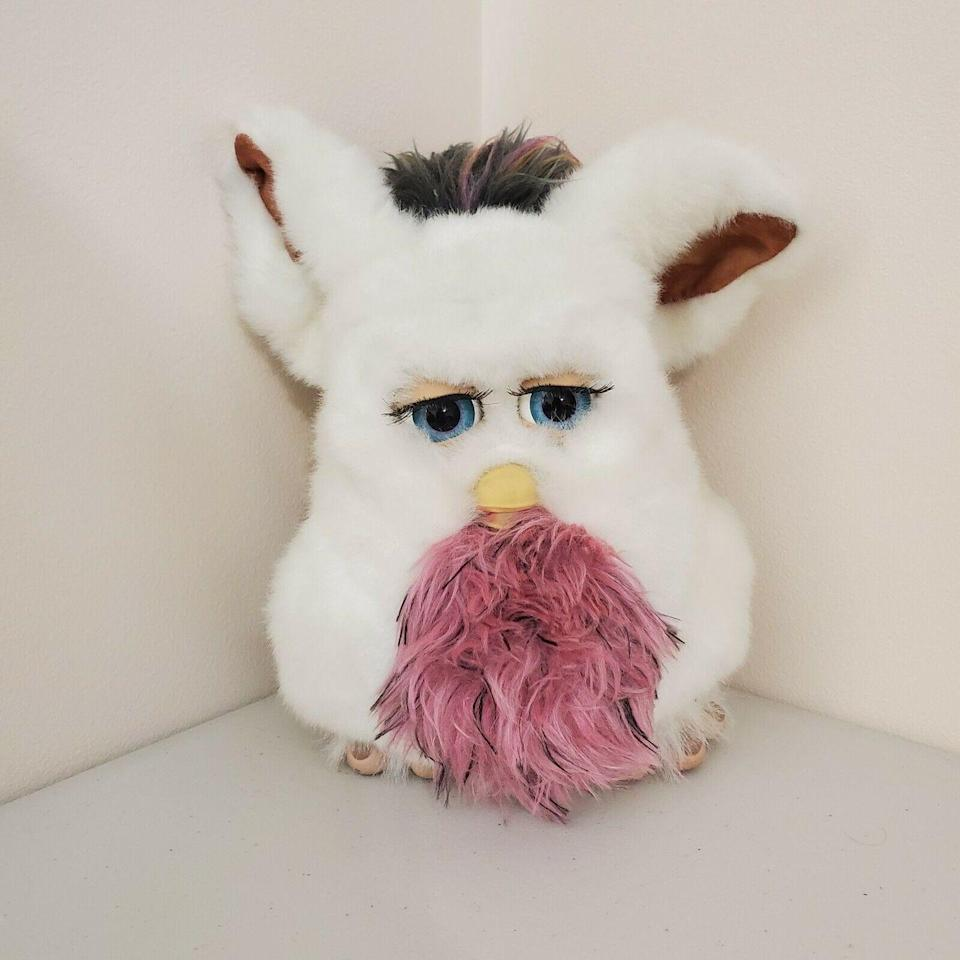 "<p>The Furby hype was real in the '90s and early '00s despite the creepy vibe they give off. (Have you seen those eyes?!) The White Passionfruit fluffy friend <a href=""https://www.ebay.com/itm/FURBY-2005-TIGER-ELECTRONICS-Talking-Toy-HASBRO-EMOTO-TRONIC-White-Passionfruit/114386830789?hash=item1aa1fc85c5:g:-zkAAOSwkgZdHNfE"" rel=""nofollow noopener"" target=""_blank"" data-ylk=""slk:is valued"" class=""link rapid-noclick-resp"">is valued</a> at $850.</p>"