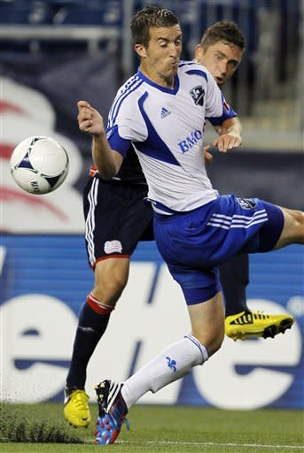 Montreal Impact midfielder Jeb Brovsky, front, and New England Revolution's Chris Tierney, rear, vie for control of the ball during the second half of an MLS soccer match in Foxborough, Mass., Sunday, Aug. 12, 2012. Impact won 1-0. (AP Photo/Steven Senne)