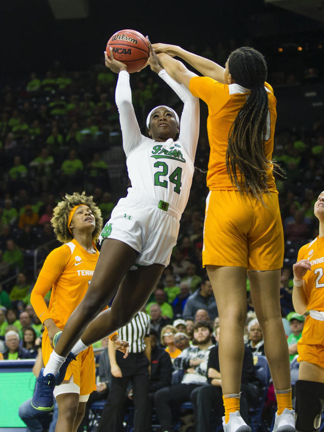 Notre Dame's Destinee Walker (24) gets blocked by Tennessee's Tamari Key (20) during an NCAA college basketball game Monday, Nov. 11, 2019 at Purcell Pavilion in South Bend, Ind. (Michael Caterina/South Bend Tribune via AP)