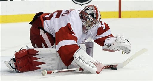 Detroit Red Wings goalie Jimmy Howard makes a stop against the Nashville Predators in the second period of an NHL hockey game on Monday, Dec. 26, 2011, in Nashville, Tenn. Howard stopped 31 of 32 shots as the Red Wings won 4-1. (AP Photo/Mark Humphrey)