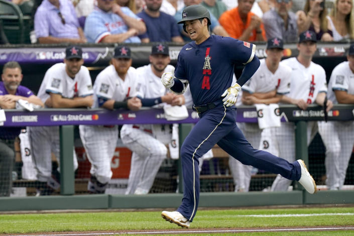 American League's Shohei Ohtani, of the Los Angeles Angeles, runs out his ground out during the first inning of the MLB All-Star baseball game, Tuesday, July 13, 2021, in Denver. (AP Photo/Gabriel Christus)
