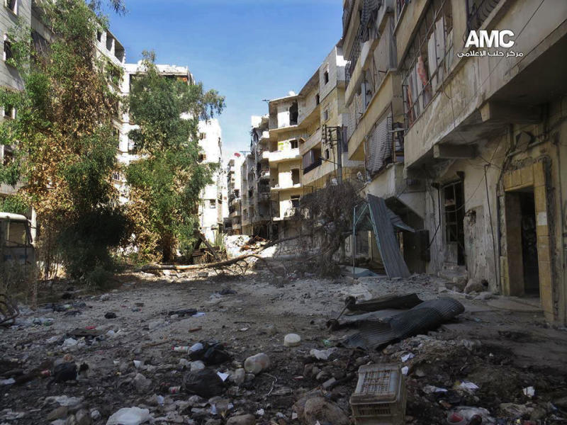 This Tuesday, Sept. 3, 2013 citizen journalism image provided by Aleppo Media Center AMC which has been authenticated based on its contents and other AP reporting, shows damaged residential buildings due to clashes between Free Syrian army fighters and government forces in Aleppo, Syria. The United States is considering launching a punitive strike against the regime of Syrian President Bashar Assad, blamed by the U.S. and the Syrian opposition for an Aug. 21 alleged chemical weapons attack in a rebel-held suburb of the Syrian capital of Damascus. (AP Photo/Aleppo Media Center, AMC)