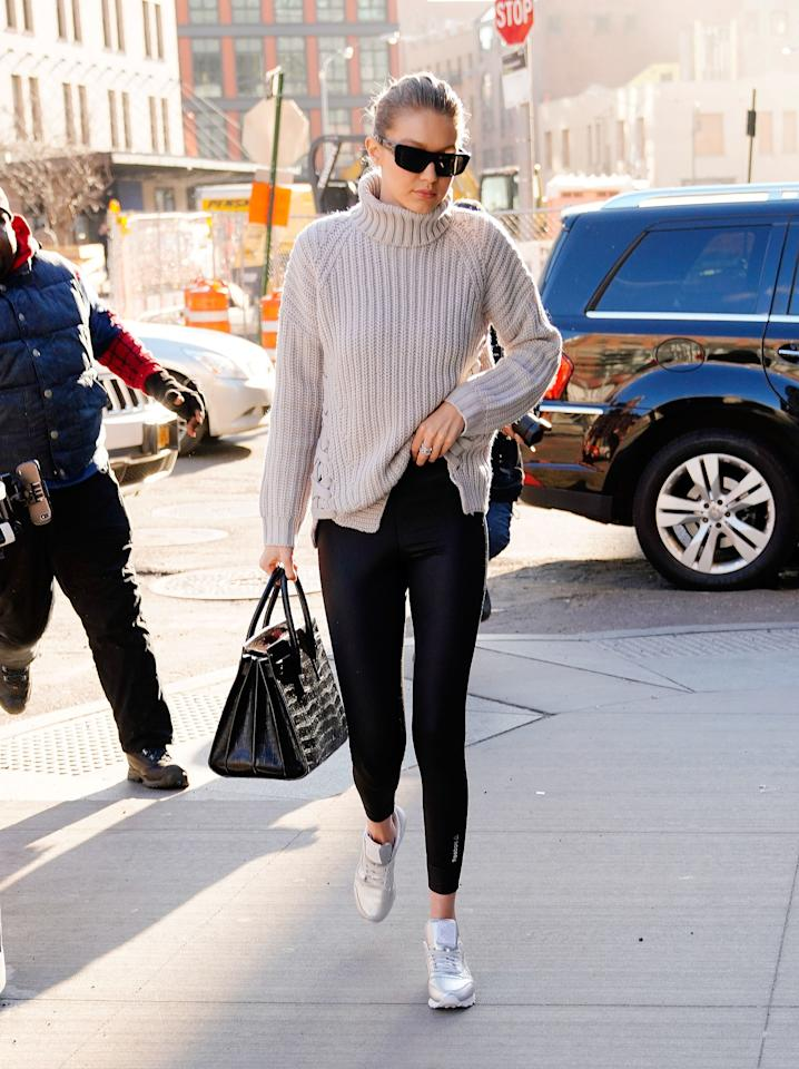 """Make like Gigi Hadid and pull the collar up over your face when the wind hits you the wrong way. It might look silly, but it's infinitely better than that """"Ugh, I'm freezing"""" scowl."""