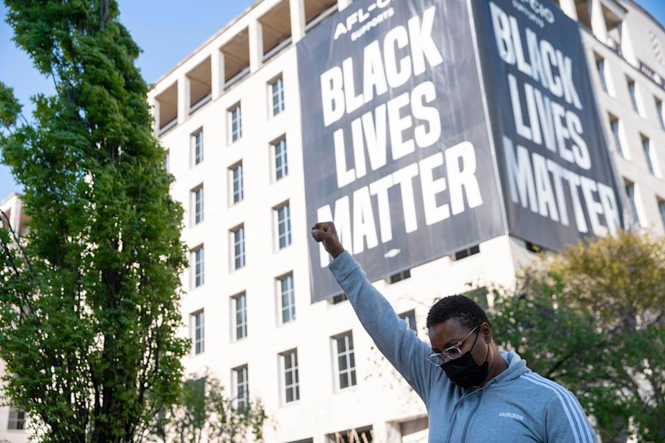 A person celebrates the verdict of the Derek Chauvin trial at Black Lives Matter Plaza near the White House on April 20, 2021 in Washington, D.C.