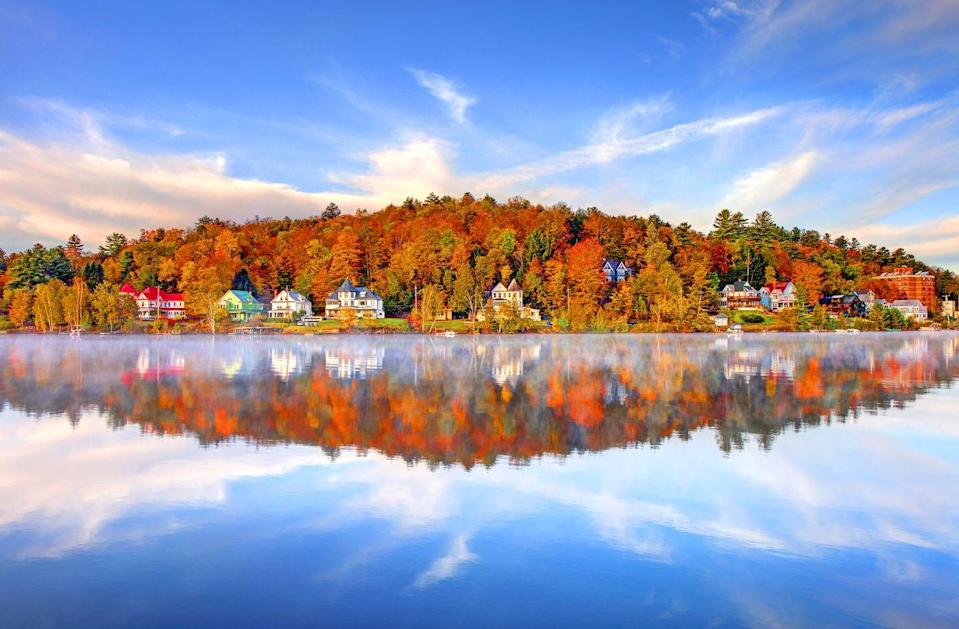 """<p>The Adirondacks have one of the longest fall foliage seasons in the Northeast, lasting from mid-September through mid-October. Visit this picturesque village for some of the region's best leaf peeping, plus plenty of beautiful lakes, mountains, and hiking trails.</p><p><a class=""""link rapid-noclick-resp"""" href=""""https://go.redirectingat.com?id=74968X1596630&url=https%3A%2F%2Fwww.tripadvisor.com%2FHotels-g48561-Saranac_Lake_New_York-Hotels.html&sref=https%3A%2F%2Fwww.thepioneerwoman.com%2Fhome-lifestyle%2Fg36804013%2Fbest-places-to-see-fall-foliage%2F"""" rel=""""nofollow noopener"""" target=""""_blank"""" data-ylk=""""slk:FIND A HOTEL"""">FIND A HOTEL</a></p>"""