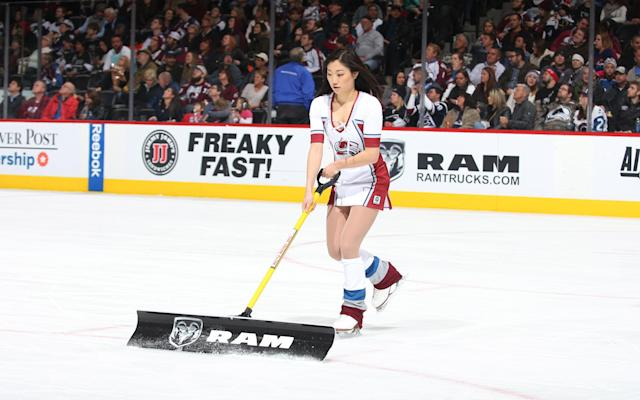 <p>A member of the Colorado Avalanche ice girls clears the ice during a time out against the Los Angeles Kings at the Pepsi Center on January 4, 2016 in Denver, Colorado. (Photo by Michael Martin/NHLI via Getty Images) </p>