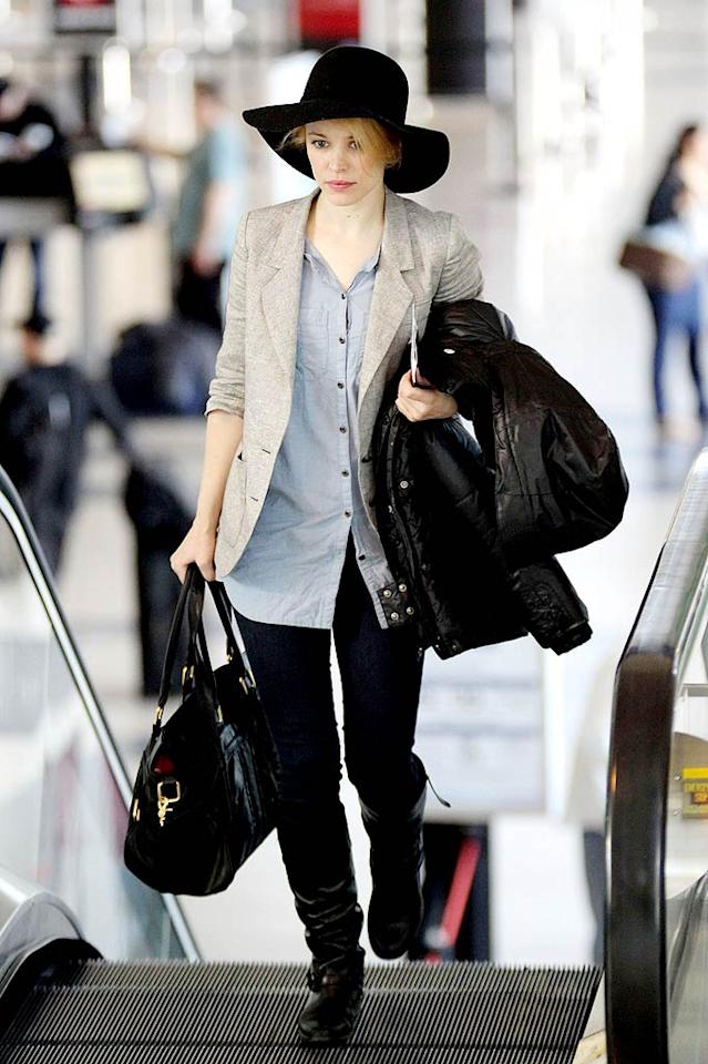 """Rachel McAdams recently tried to remain incognito while making her way through LAX, but her attempt was unsuccessful thanks to her """"look at me, I'm a celebrity"""" chapeau and equally obvious slouchy riding boots. You're not fooling (nor impressing) anyone, Ms. McAdams. Pedro Andrade/<a href=""""http://www.pacificcoastnews.com/"""" target=""""new"""">PacificCoastNews.com</a> - March 5, 2011"""