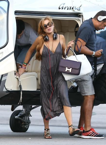 Lindsay Lohan Flaunts Some Major Side Boob As Her Cleavage Makes A Break For Freedom In Brazil (PHOTOS)