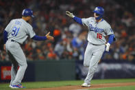 Los Angeles Dodgers' Will Smith (16) is congratulated by third base coach Dino Ebel (91) after hitting a home run against the San Francisco Giants during the eighth inning of Game 2 of a baseball National League Division Series Saturday, Oct. 9, 2021, in San Francisco. (AP Photo/John Hefti)
