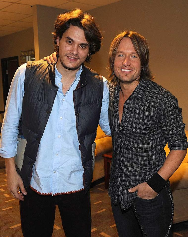 "Country singer Keith Urban got some help from pals like John Mayer on Tuesday night at Bridgestone Arena in Nashville, Tennessee, during the ""We're All for the Hall"" benefit concert. The show was a follow up to one last year that raked in almost $500,000 for the Country Music Hall of Fame. Rick Diamond/<a href=""http://www.gettyimages.com/"" target=""new"">GettyImages.com</a> - October 5, 2010"