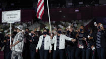 <p>Sue Bird and Eddy Alvares, of the United States of America, carry their country's flag during the opening ceremony in the Olympic Stadium at the 2020 Summer Olympics, Friday, July 23, 2021, in Tokyo, Japan. (AP Photo/Natacha Pisarenko)</p>