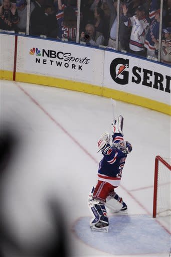 New York Rangers goalie Henrik Lundqvist (30), of Sweden, reacts after Game 7 of a second-round NHL hockey Stanley Cup playoff series against the Washington Capitals, Saturday, May 12, 2012, in New York. The Rangers won 2-1. (AP Photo/Frank Franklin II)