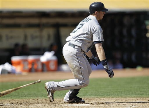 Seattle Mariners' Justin Smoak watches his RBI single hit off Oakland Athletics' Tommy Milone in the third inning of a baseball game Sunday, Sept. 30, 2012, in Oakland, Calif. (AP Photo/Ben Margot)