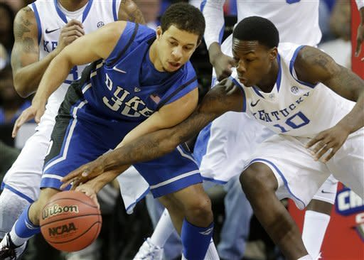 Kentucky guard Archie Goodwin (10) tries to steal the ball from Duke guard Seth Curry (30)during the first half of an NCAA college basketball game at the Georgia Dome in Atlanta Tuesday, Nov. 13, 2012. (AP Photo/Dave Martin)