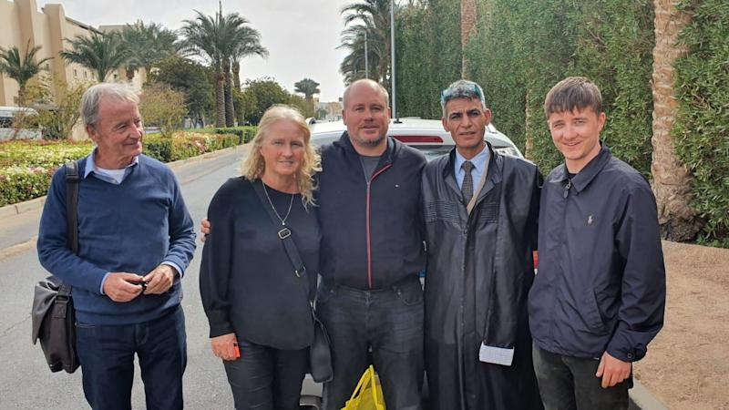Briton detained in Egypt over 'pat on back' tired but happy after flying home