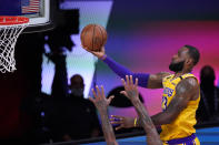 Los Angeles Lakers' LeBron James (23) goes up for a shot against the Houston Rockets during the second half of an NBA conference semifinal playoff basketball game Thursday, Sept. 10, 2020, in Lake Buena Vista, Fla. (AP Photo/Mark J. Terrill)