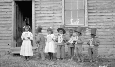 """Children hold letters that spell """"Goodbye"""" at Fort Simpson Indian Residential School, in Fort Simpson, Northwest Territories in a 1922 archive photo. REUTERS/J.F. Moran/Library and Archives Canada/PA-102575/handout"""