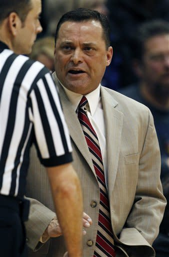 Texas Tech coach Billy Gillispie speaks to an official during the first half of an NCAA college basketball game against Kansas in Lawrence, Kan., Saturday, Feb. 18, 2012. (AP Photo/Orlin Wagner)
