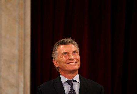Argentina's President Mauricio Macri smiles during the opening of a new legislative session in Buenos Aires