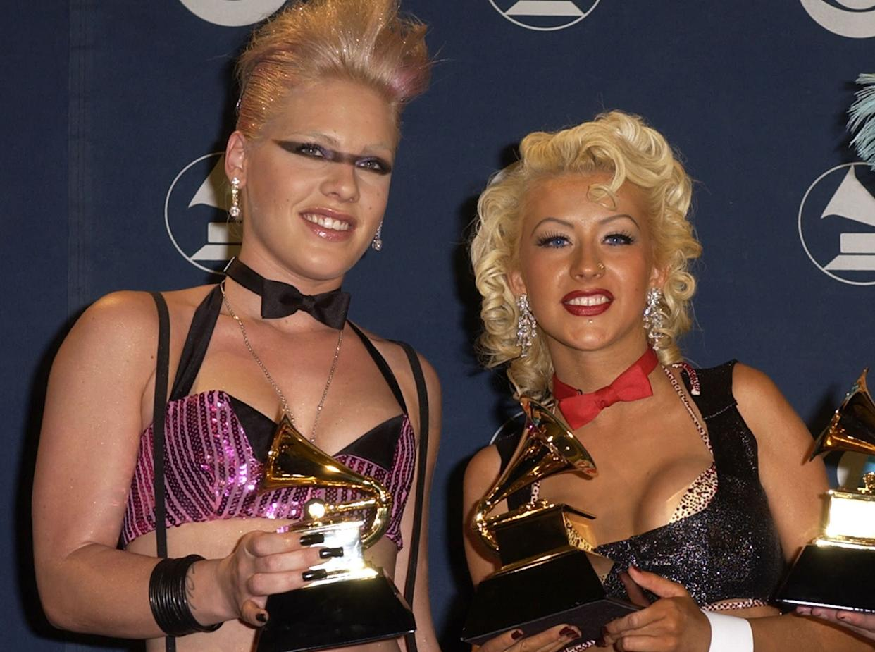 Pink and Christina Aguilera pose together at the 2002 Grammy Awards.  (Photo: SGranitz via Getty Images)