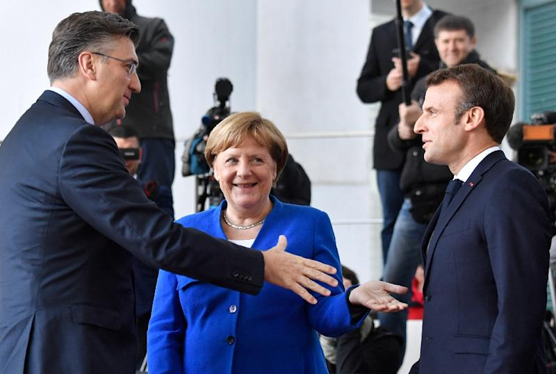 Macron (R) had hoped to cultivate German Chancellor Angela Merkel (C) as a key ally to reform Europe (AFP Photo/John MACDOUGALL)