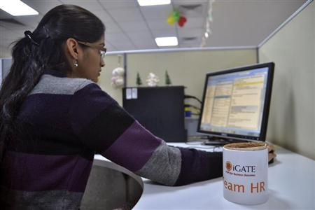 An employee works at the Indian headquarters of iGate in Bangalore February 4, 2013. REUTERS/Stringer/Files
