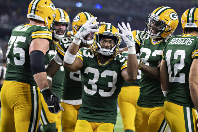Aaron Jones of the Green Bay Packers celebrates after scoring his fourth touchdown against Dallas. (Getty Images)